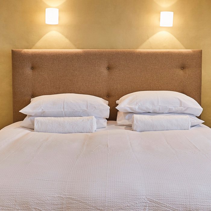 Fresh Linens on a crisp and comfortable bed
