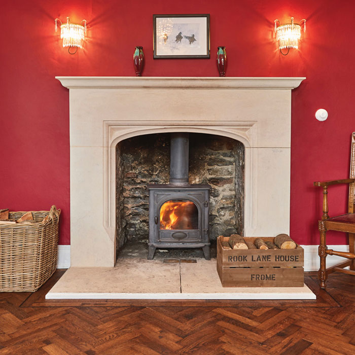 Warm, welcoming and rustic fireplace at Rook Lane House Frome