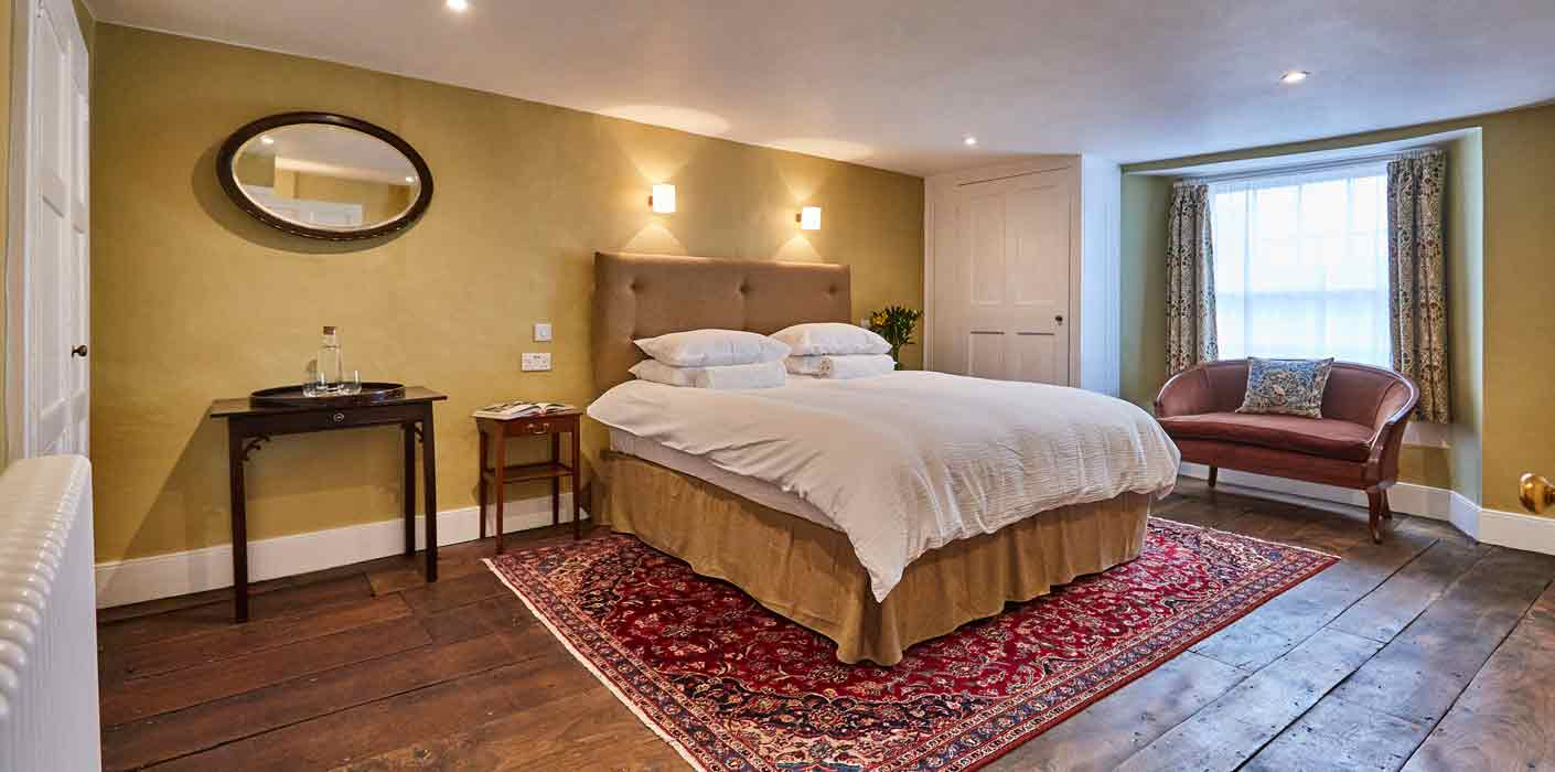 Well lit and luxury king bedroom at boutique Frome Bed and Breakfast