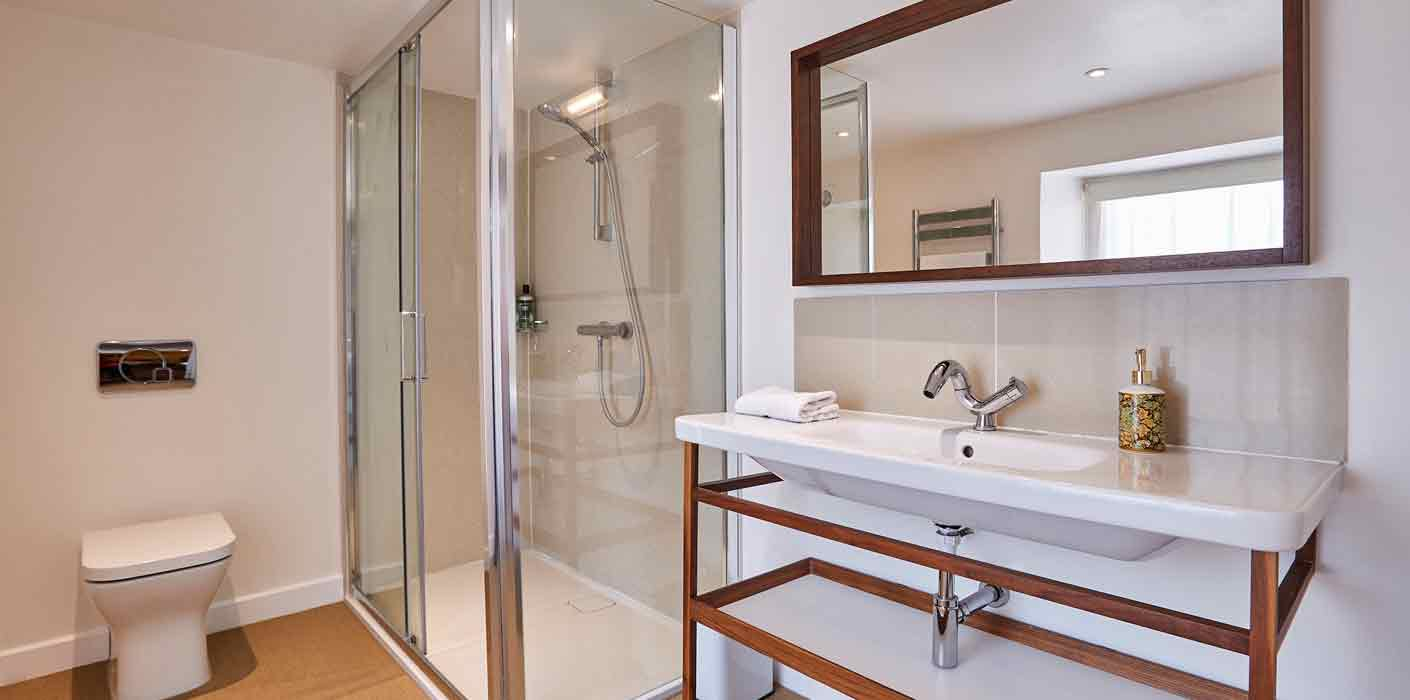 Crisp and clean shower and toilet.