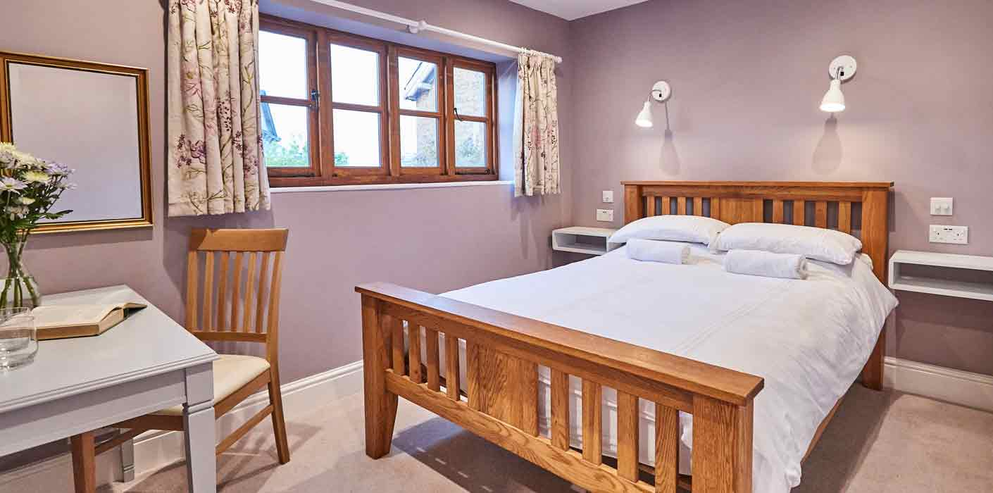 Warm and welcoming double bedroom in Rook Lane House